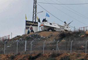 Israeli soldiers patrol near the Lebanese border