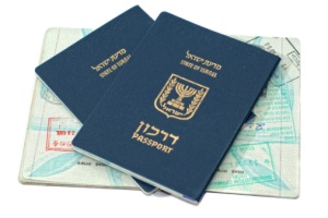 Israeli passports passport sitting on an open passport with passport stamps