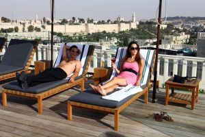 Israeli girl sunbathing on the roof of Mamila hotel
